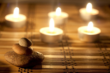 spa stones and candles in night background