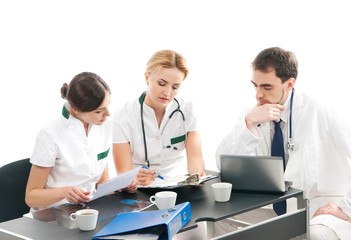 A team of three young Caucasian doctors in white clothes