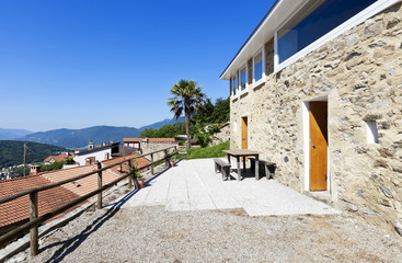 holiday home in the mountains, outdoor view, stone facade