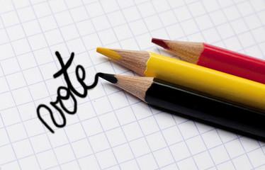 vote écriture avec crayons de couleurs drapeau belge