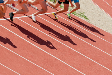the shadow of the runners at the starting line