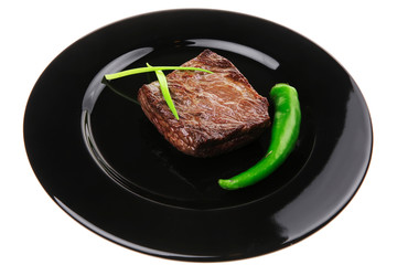 meat food : roasted fillet mignon on black plate with chives