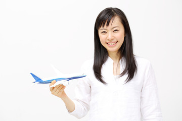 模型飛行機を持つ女の子