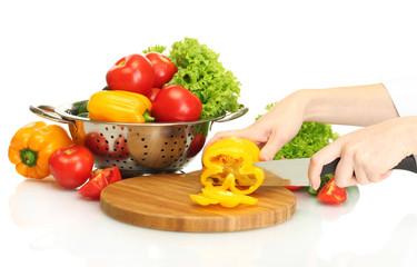 woman hands cutting vegetables on kitchen blackboard