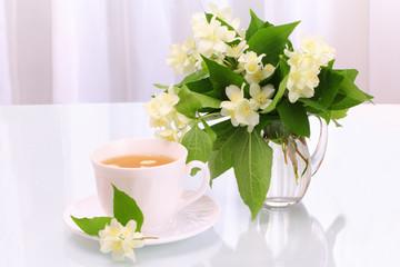Cup of tea and jasmine flowers