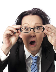 amazed businesswoman with glasses off