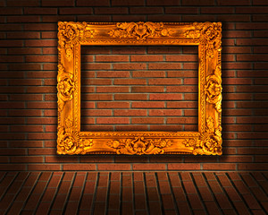 picture frames on brick wall