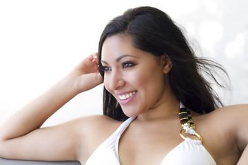 Smiling Brunette in white bikini top