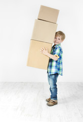 Boy holding pyramid of carton boxes. Packing up to move. Growth