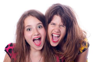 Two beautiful happy teenage girls screaming