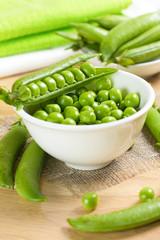 Fresh green peas on the white bowl