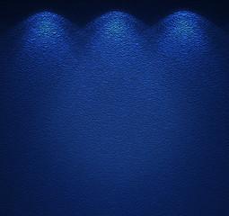 Illuminated texture of the blue wall