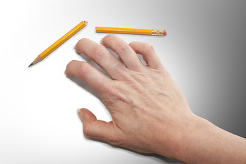 Frustrated hand fingers with broken pencil isolated shadow