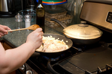 Cooking on stove in kitchen