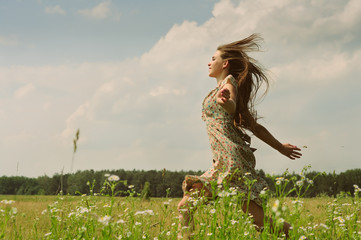 Girl running the meadow