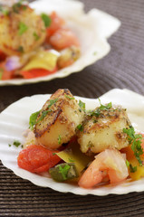 Seared scallops on marinated vegetables