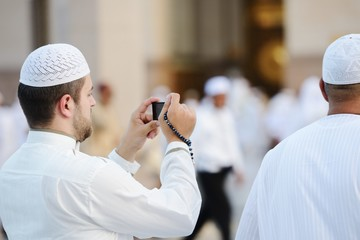 Wall Mural - Muslim taking photo at Madina haram