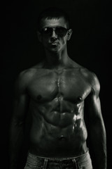 Muscular young man. Bw