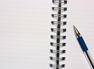 Notebook and pencil on a white background.