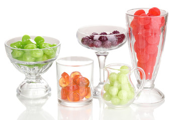 Color candies in glasses isolated on white