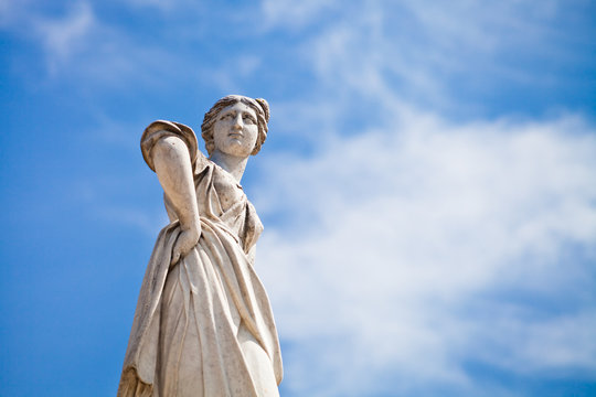 woman's statue in antique Roman style