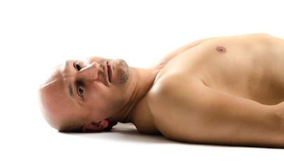 Naked man on floor