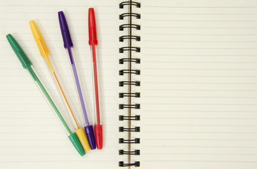 Notebook and colorful pens