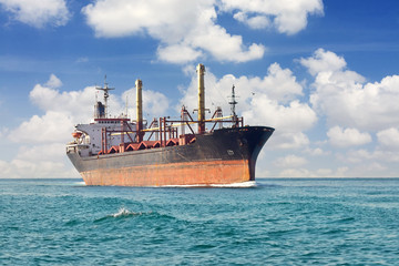 Dry cargo ship sails in the open sea