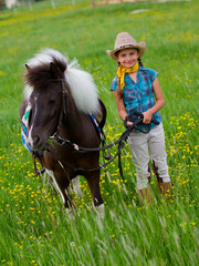 Lovely cowgirl grazing a pony