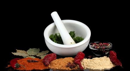 Composition of White mortar and pestle with spice and