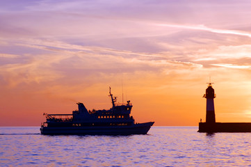 Sochi, the ship enters the port at sunset