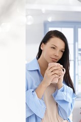 Young woman with morning tea