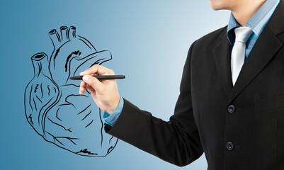 businessman drawing heart diagram