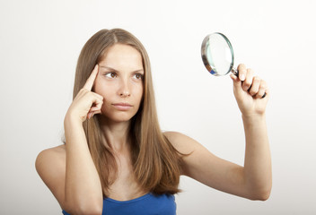 Woman with Magnifying Glass, research