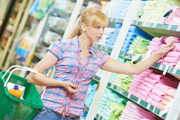 Shopping woman at household good supermarket