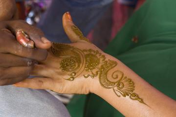 applying fresh henna on hand, wedding ,Rajasthan, India