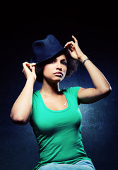 Cute Black Woman Wearing a Hat with Serious Expression