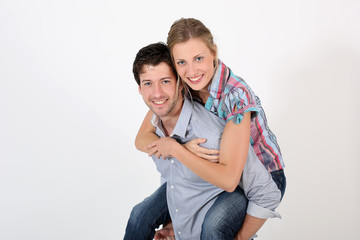 Young man carrying girlfriend on his back