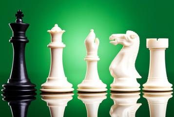 black king near white chess pieces