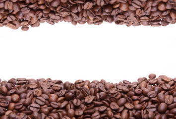 Two lines of roasted coffee beans