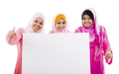 muslim women holding a white board