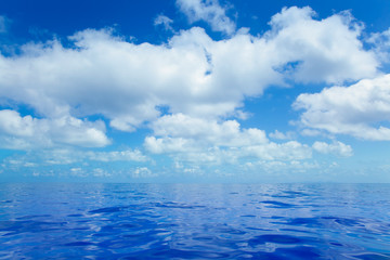 Blue calm sea water in with clouds mirror surface