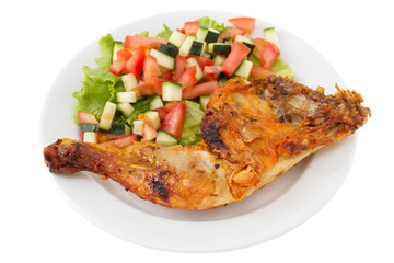 grilled chicken with vegetable salad on the plate