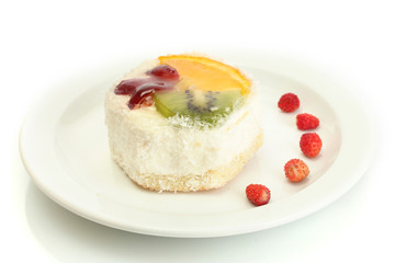 sweet cake with fruits on plate isolated on white