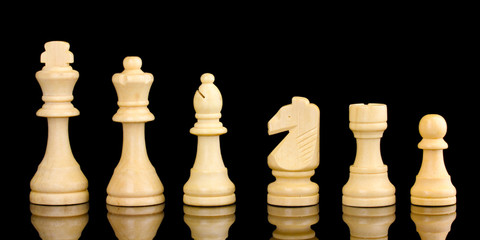 Chess pieces isolated on black