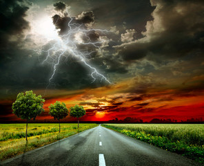 Asphalt road and lightning