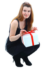 Excited attractive woman with gift boxe