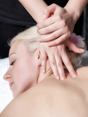 Closeup photo of masseur's hands doing deep tissue massage