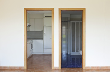 two doors, entrance  of the kitchen and bathroom