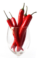 bunch of red chili peppers in a glass